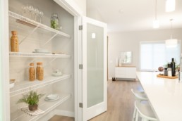 Closet pantry in open concept kitchen with organization ideas. Located in St. Albert