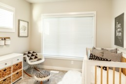 Modern design childrens bedroom with balck and white accents and wood tones. Located in Jensen Lakes St. Albert. Experience lake living.