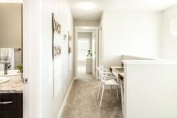 Spacious loft hallway with working desk and boho interior design.