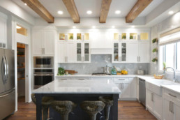 Exposed beams in large open kitchen in Sarasota Homes showhome in Jensen Lakes.