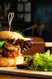 Gourmet burger and salad at upscale restaurant in Jensen Lakes Crossing, St. Albert