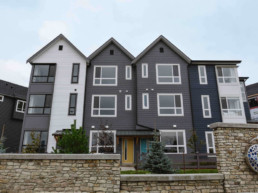 Cobalt beach townhome outisde view in Jensen lakes St. Albert, white grey and navy home exterior with black and white trim.