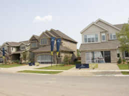 View from street of showhome parade in Jensen Lakes