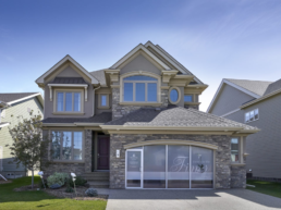 Beautiful architecture in Jensen Lakes, showhomes now open. Brick house with traditional finishes.