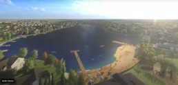 Jensen Lake aerial view. Lakeside community, beach with long dock and subdivision surrounding.