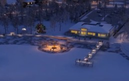 Winter community campfire and lit up pier with lights and snow in Jensen Lakes. Wintertime in St. Albert.