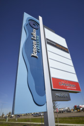Jensen Lakes by Melcor in St. Albert. Roadside sign with blue logo.