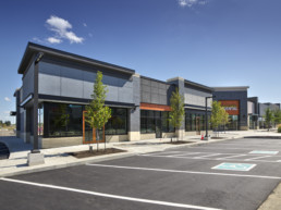 Modern architecture commercial area with grey stone. Jensen Lakes St. Albert businesses.